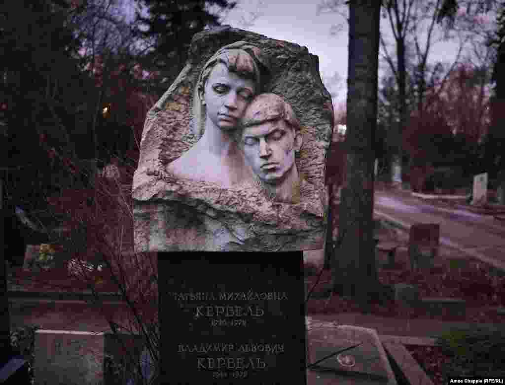 A headstone to Tatyana and Vladimir Kerbel, the wife and son of famous sculptor Lev Kerbel. These long-exposure images were shot in the darkness at Novodevichy.