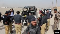 FILE: Police inspect the scene of a roadside bomb blast that their vehicle in Balochistan's capital, Quetta.