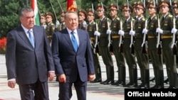 Tajik President Emomali Rahmon (left) welcomes Kazakh President Nursultan Nazarbaev to Dushanbe on September 14.