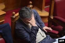 Greek Finance Minister Euclid Tsakalotos attends a parliamentary session at the Greek parliament in Athens on July 15.