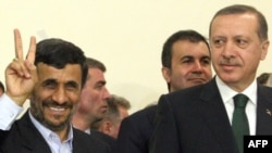 Iranian President Mahmud Ahmadinejad welcomes Turkish Prime Minister Recep Tayyip Erdogan to Tehran last year, in what at the time appeared a direct challenge to Western efforts to isolate Iran over its nuclear program.