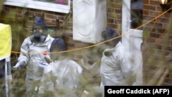 Investigators work in the garden of Sergei Skripal's house in Salisbury in March.