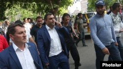 Armenia - Mayor Karen Grigorian (second from left) joins his supporters rallying in Echmiadzin, 16 June 2018.