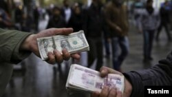 Foreign exchange traders on the streets of Tehran. FILE PHOTO