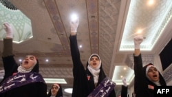 Female members of the Basij Islamist militia shout slogans during a ceremony marking the 30th anniversary of its establishment at the Imam Khomeini Grand Mosque in Tehran last year.