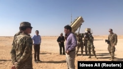 FILE - U.S. Defense Secretary Mark Esper speaks with U.S. troops in front of a Patriot missile battery at Prince Sultan Air Base, October 22, 2019