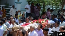 Relatives carry the body of Indian engineer Srinivas Kuchibhotla, who was shot dead in the U.S. state of Kansas, for his funeral in Hyderabad on February 28.