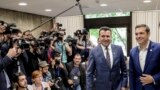 Macedonian Prime Minister Zoran Zaev (left) and his Greek counterpart Alexis Tsipras smile for reporters at a meeting in Sofia on May 17.