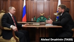Russian President Vladimir Putin (left) meets with Chechen leader Ramzan Kadyrov at the Kremlin on April 19.