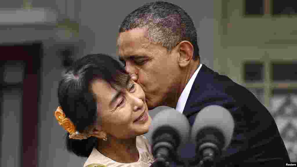U.S. President Barack Obama kisses Aung San Suu Kyi during a visit to her residence in Yangon, Burma, on November 19.