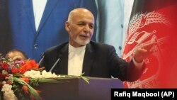 Afghan President Ashraf Ghani delivers a speech during an election campaign rally in Kabul on August 5.
