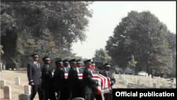 USA -- The casket containing the remains of the crew of a U.S. military plane shot down over Soviet Armenia in 1958 is escorted to a gravesite in Arlington National Cemetery by the US Air Force Honor Guard.