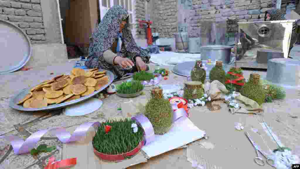 Afghanistan -- A woman prepares decorations for the new year in Herat city, 19Mar2012