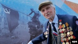 Russia -- A World War Two veteran takes part in the Victory Day celebrations, marking the 71st anniversary of the victory over Nazi Germany in World War Two, on Red Square in Moscow, May 9, 2016