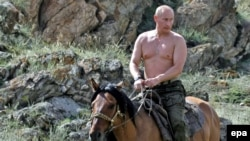 Then-Russian Prime Minister Vladimir Putin rides a horse during while on vacation in the Republic of Tuva in August 2009.