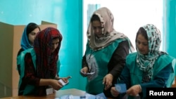 Afghanistan - Election officials count ballot papers the end of polling in Kabul June 14, 2014.