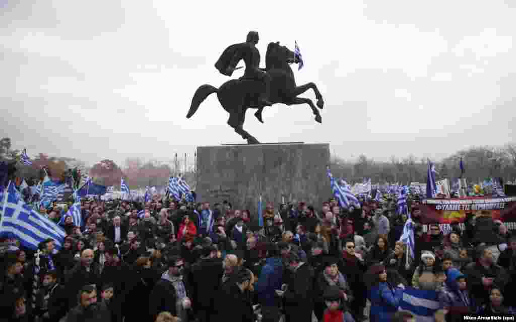 "The crowd surrounds a statue of Alexander The Great during the Thessaloniki protest. Participants sang Greece's national anthem and held banners reading, ""There is only one Macedonia and it is Greek!"""