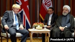 Iranian President Hassan Rohani (R) meets with British Prime Minister Boris Johnson on the sidelines of the 74th United Nations General Assembly in New York, September 24, 2019
