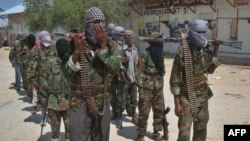 Al-Shabab recruits walk down a street in the Deniile district of Mogadishu in March 2012.