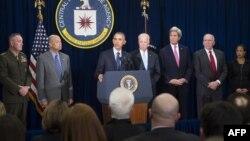 АҚШ президенті Барак Обама (ортада мінберде) Орталық барлау басқармасында ұлттық қауіпсіздік жөніндегі кеңесшілерімен кездесіп тұр. Вашингтон, 13 сәуір 2016 жыл.