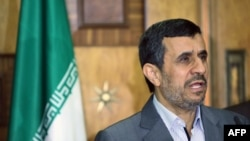 Outgoing Iranian President Mahmud Ahmadinejad speaks at a press conference in Baghdad on July 18.