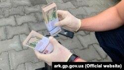 Изъятая партия фальшивых долларов, 18 августа 2021 года