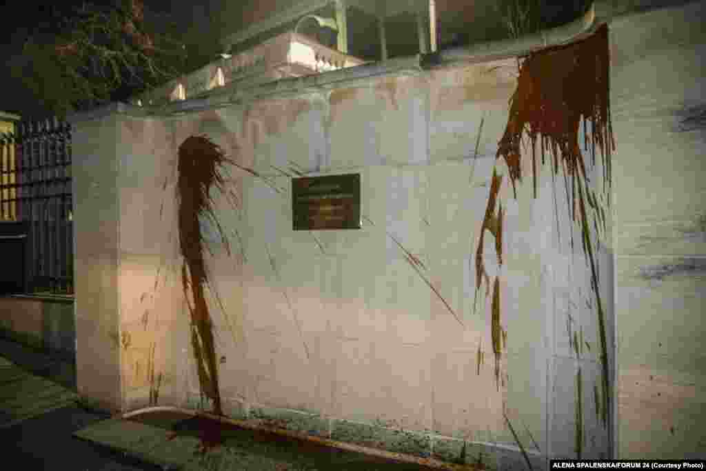"The wall outside the Russian Embassy in Prague was sprayed with ketchup overnight on April 18 during a protest staged to call attention to the deaths of the two people in the 2014 explosion. Moscow warned about its response to the expulsions. ""Prague is well aware of what comes after such hocus-pocus,"" Foreign Ministry spokeswoman Maria Zakharova said."