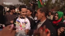 Afghan Athletes Return Home To Hero's Welcome