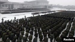 Uniformed personnel stand in formation outside the Kumsusan Memorial Palace during Kim Jong Il's funeral procession in Pyongyang