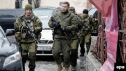 The leader of the self-proclaimed Donetsk People's Republic, Aleksandr Zakharchenko (center), walks in downtown Donetsk with other separatist rebels.