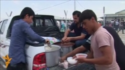 Families Continue To Flee Fighting In Iraq's Mosul