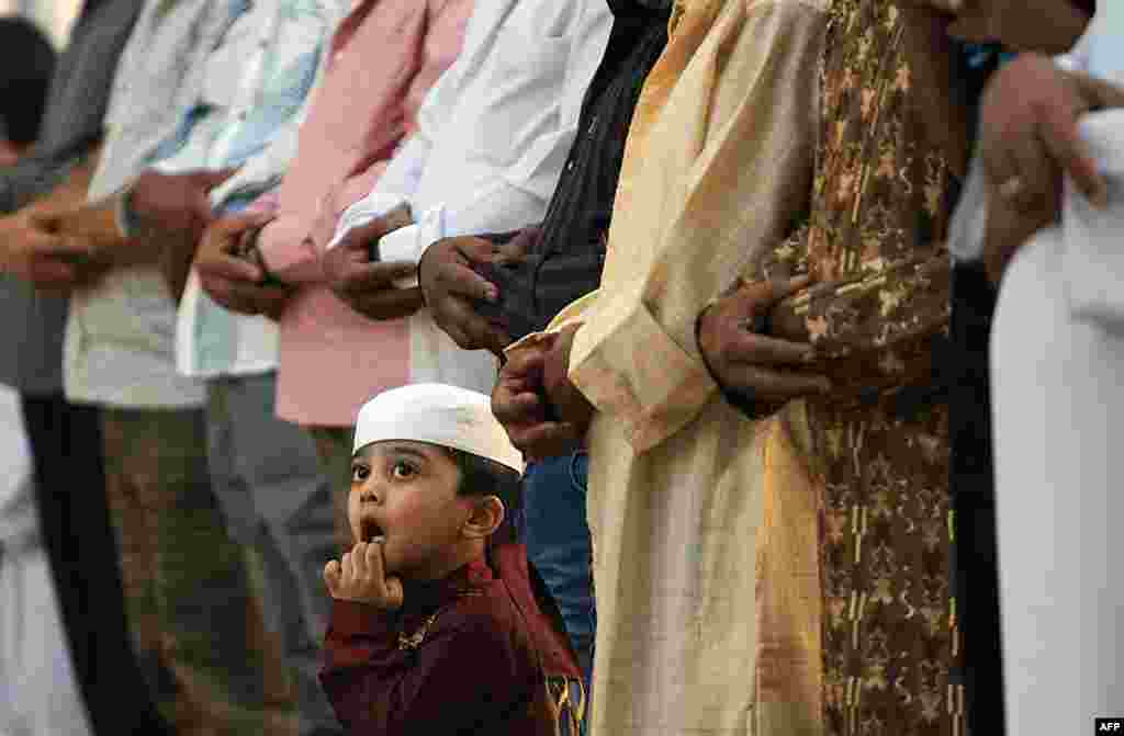 A Saudi boy looks up during the morning Eid al-Fitr prayer at the Turki bin Abdullah grand mosque in Riyadh. (AFP/Fayez Nureldine)