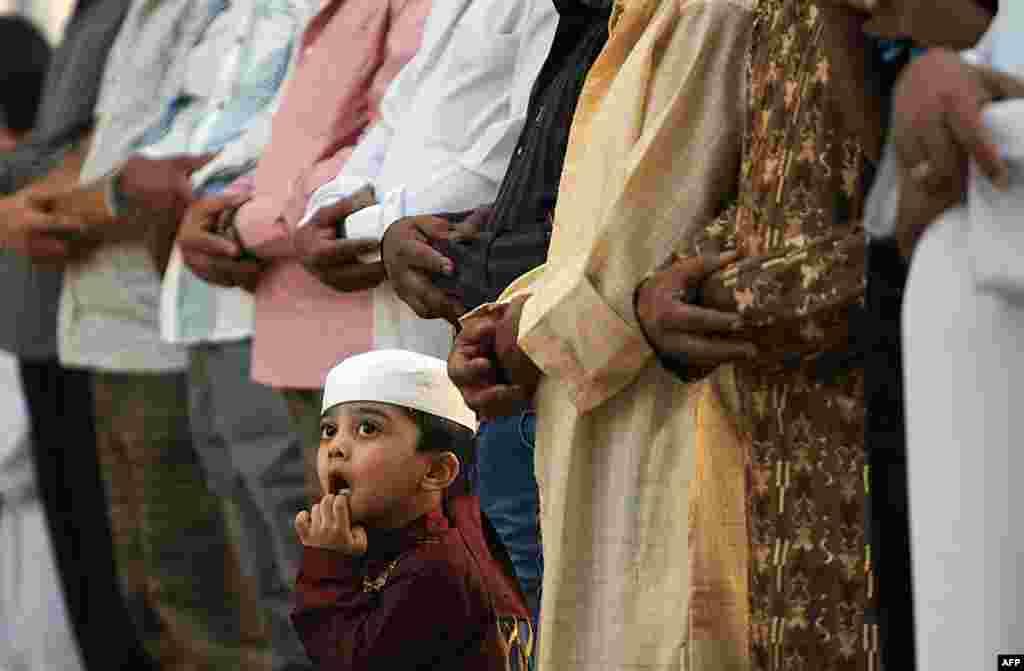 A Saudi boy looks up during the morning Eid al-Fitr prayer at the Turki bin Abdullah grand mosque in Riyadh. (AFP/Fayez Nureldine)
