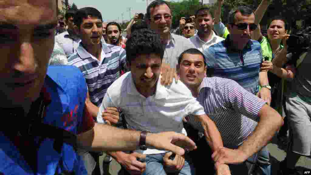 Activists attempted to use Baku's 2012 stint as Eurovision host as an opportunity to call attention to the regime's dismal rights record. Here, plainclothes police officers detain protesters outside Azerbaijan's public television station during the week of the Eurovision broadcasts.