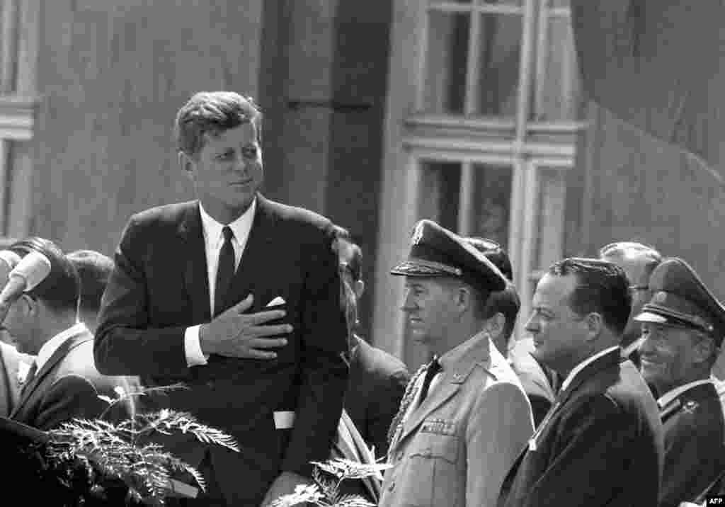 "President Kennedy gives a speech at the Schoeneberg city hall in Berlin on June 26, 1963. It was here that he made his famous statement, ""Ich bin ein Berliner"" (I am a Berliner) to underscore U.S. support for West Germany and empathy for people living in the divided city of Berlin."