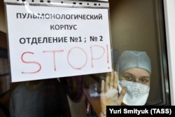 A medical staff member peers out of the pulmonary department of a Vladivostok hospital.