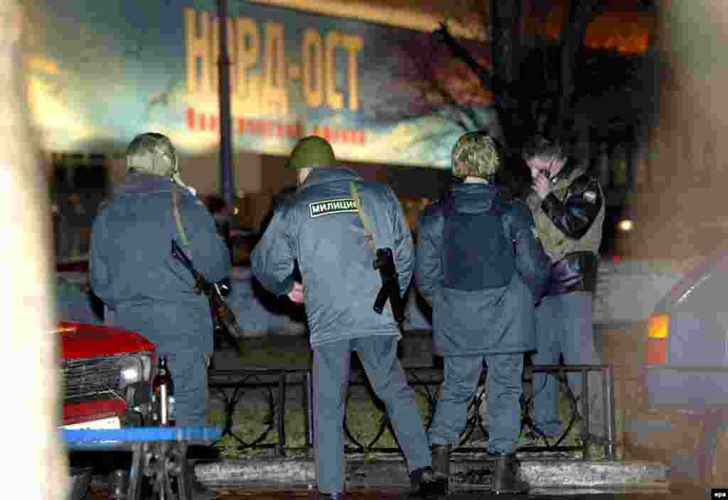 Russian police stand outside the Dubrovka theater in Moscow after Chechen extremists stormed the building and took between 900 and 1,000 people hostage on the evening of October 23, 2002.