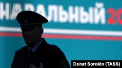 A police officer is silhouetted during an anti-corruption rally in St. Petersburg. The Russian Prosecutor-General's Office reported that the most frequent cases of alleged corruption so far this year had been registered among law enforcement officers. (file photo)