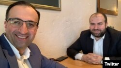 Armenia - Health Minister Arsen Torosian (L) takes a selfie with Environment Minister Erik Grigorian at a smoke-free restaurant in Yerevan, February 7, 2019.
