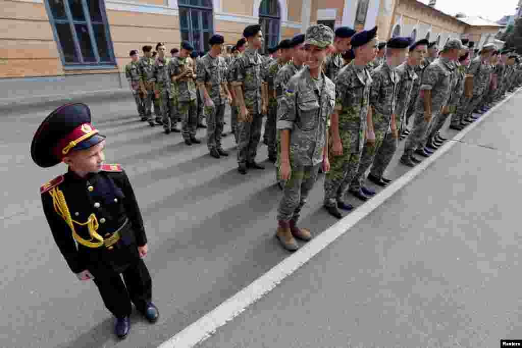 Students of a cadet school attend a ceremony to mark the start of a new school year in Kyiv on September 1. (Reuters/Valentyn Ogirenko)