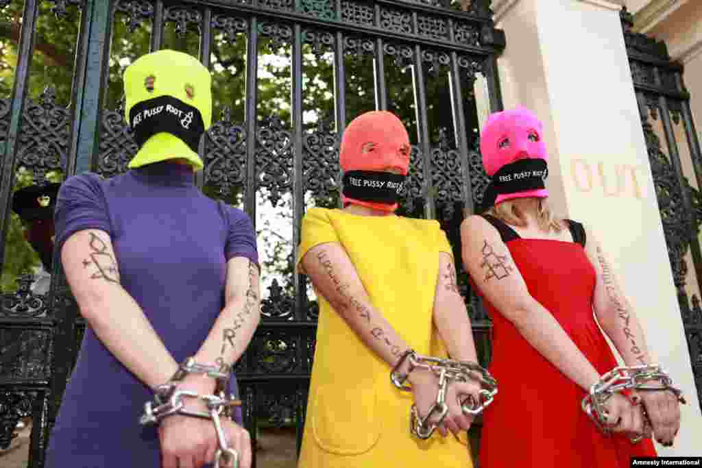 Protesters join a demonstration in support of Pussy Riot led by rights watchdog Amnesty International near the Russian Embassy in London on August 16.