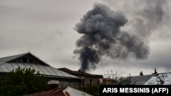 Smoke rises behind houses after shelling in Nagorno-Karabakh. The recent escalation in hostilities in the breakway region has also seen a surge in tweets about the conflict.