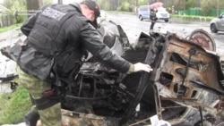 Civilians Die As Shells Rip Apart Cars Near Donetsk