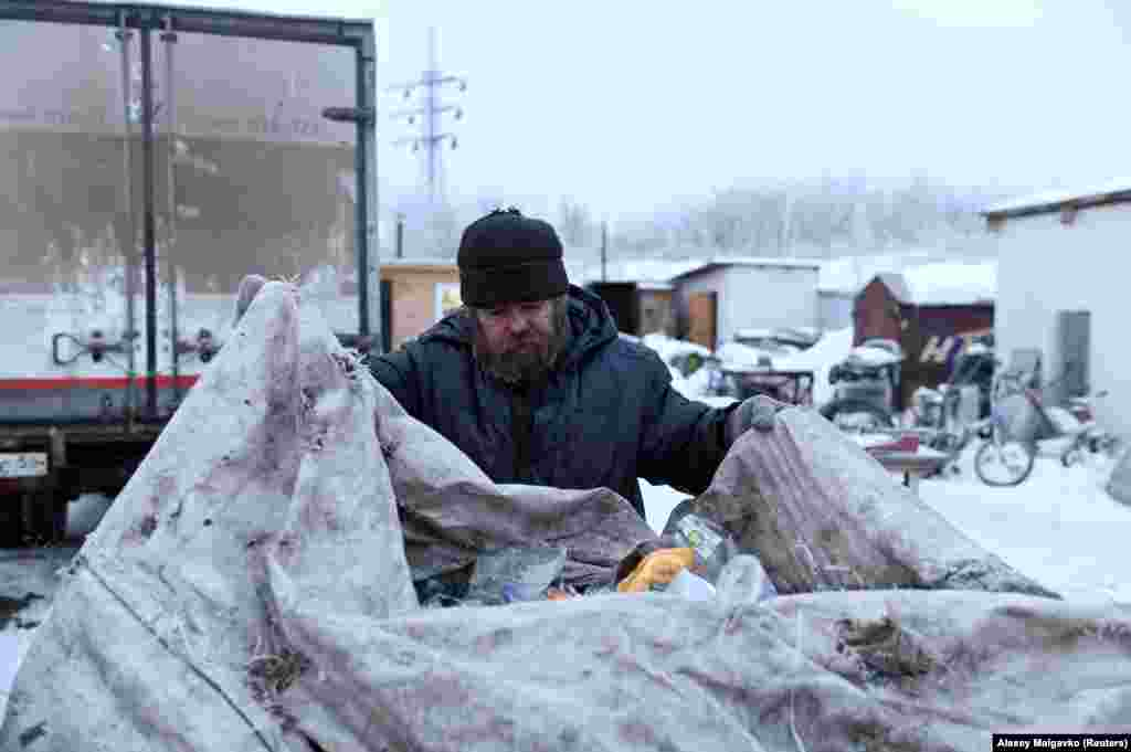 Vergunov brings bottles and aluminum cans to a recycling center.Omsk, which lies three time zones east of Moscow, has a night shelter for the homeless, but it's in a distant part of town. Vergunov doesn't sleep there, needing instead to stay close to where he earns his keep.