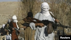 Well-armed Taliban fighters at an undisclosed location in Nangarhar Province on December 13