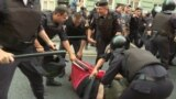 Russia - police beat a protester in St. Petersburg during a protest over pension reform. screen grab protests demonstration