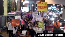 Demonstrators march in protest against the election of Republican Donald Trump as president of the United States.