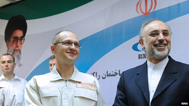 Russia's nuclear agency chief Sergei Kiriyenko (left) meets with his Iranian counterpart, Ali Akbar Salehi, before the launch of the Bushehr plant.