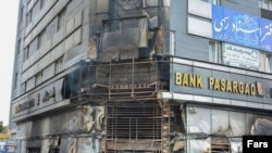A building housing a bank is seen on November 17 after it was attacked during protests in Iran.