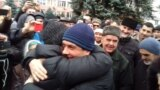 "Crimean lawyer Emil Kurbedinov (center) is greeted by supporters upon being released from jail on December 11 after serving a five-day sentence on ""extremism"" charges."